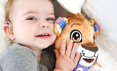 Niño con León